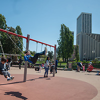 Children play in a playground near the Embarcadero in San Francisco, California.
