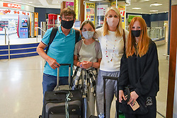 © Licensed to London News Pictures. 04/06/2021.Manchester, UK. . Louise Hadfield, Liv, Ava and Mike, arrived from a Faro flight at Terminal 1 of Manchester airport. From 4am on Tuesday 8 June, Portugal will be removed from the Green list and added to the Amber list. Photo credit: Ioannis Alexopoulos/LNP