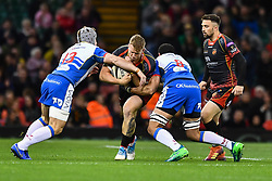27th April 2019 , Principality Stadium , Cardiff, Wales ; Guinness pro 14's, Round 21, Dragons vs Scarlets ; Jack Dixon of Dragons is tackled by Jonathan Davies of Scarlets<br /> <br /> Credit :  Craig Thomas/Replay Images