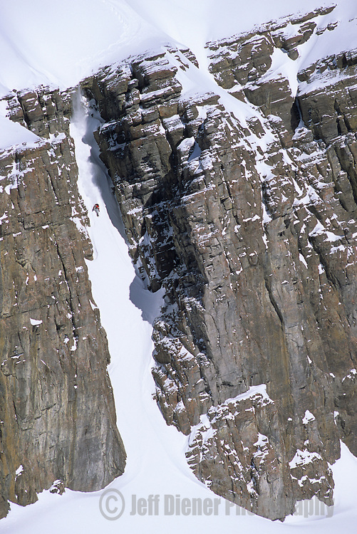 """A snowboarder speeds down the """"Gothic Couloir"""" in the Jackson Hole backcountry, Wyoming."""