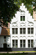 Belgian architecture crow-stepped gable ( crow steps) at Beguinage convent - Begijnhof monastery / nunnery, Bruges, Belgium