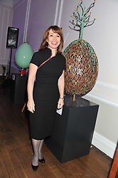 KAY BURLEY at a champagne reception to launch The Big Egg Hunt presented by Faberge in aid of the charities Action for Children and Elephant Family held at 29 Portland Place, London on 18th January 2012.