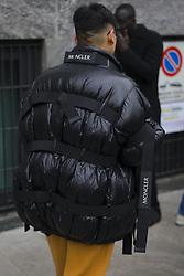 January 15, 2018 - Milan, Italy - A guest wearing black Moncler down feather jacket is seen outside Armani during Milan Men's Fashion Week Fall/Winter 2018/19 on January 15, 2018 in Milan, Italy. (Credit Image: © Nataliya Petrova/NurPhoto via ZUMA Press)
