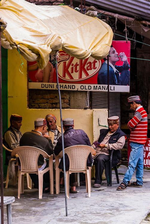 Local men playing cards, Old Manali, Himachal Pradesh, India.