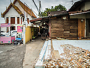 14 SEPTEMBER 2015 - BANGKOK, THAILAND: The slab and floor are all that remain of a home at Wat Kalayanamit. The home next to it is the next one scheduled to be destroyed. Fiftyfour homes around Wat Kalayanamit, a historic Buddhist temple on the Chao Phraya River in the Thonburi section of Bangkok are being razed and the residents evicted to make way for new development at the temple. The abbot of the temple said he was evicting the residents, who have lived on the temple grounds for generations, because their homes are unsafe and because he wants to improve the temple grounds. The evictions are a part of a Bangkok trend, especially along the Chao Phraya River and BTS light rail lines. Low income people are being evicted from their long time homes to make way for urban renewal.           PHOTO BY JACK KURTZ