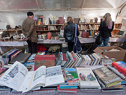 Bookstall at outdoor weekend antiques market on streets  of Paris France