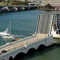Venetian Causeway drawbridge up while new  demo boats from the Sea Isle Marina take boaters for test rides.