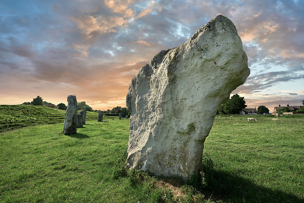 Avebury Neolithic standing stone Circle the largest in England, Wiltshire, England. Avebury is a Neolithic henge monument containing three stone circles, around the village of Avebury in Wiltshire, in southwest England. One of the best known prehistoric sites in Britain, it contains the largest megalithic stone circle in the world. Constructed over several hundred years in the third millennium BC, during the Neolithic, or New Stone Age, the monument comprises a large henge (a bank and a ditch) with a large outer stone circle and two separate smaller stone circles situated inside the centre of the monument.<br /> <br /> Visit our PREHISTORIC PLACES PHOTO COLLECTIONS for more  photos to download or buy as prints https://funkystock.photoshelter.com/gallery-collection/Prehistoric-Neolithic-Sites-Art-Artefacts-Pictures-Photos/C0000tfxw63zrUT4