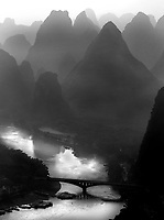 limestone karsts tower over the Li River in Yangshuo