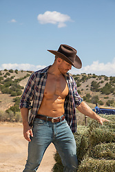 hot cowboy with open shirt working on a farm