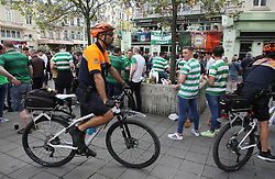 27 September 2017 Brussels: Celtic supporters in the city centre before the Champions League match against Anderlecht: police on bicycles patrol the supporters:<br /> Photo: Mark Leech