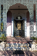 Grand mansion house with ornate lacy wrought iron porch in the Garden District, New Orleans, Louisiana, USA
