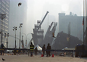 "Ground Zero New York City day 3 after the attcak on the Wolrd Trade Center. For Reuters New Agency. Through my eyes and with my camera I am able to see the world we live in, and try to bring things into focus. Photography preserves my vision of what ""I see"" at a specific time and place- a moment. Creating a bond between  me and my subject and capturing and emotion for eternity. Having lived and worked in New York City for over 15 years when 911 happened. I had to go and ""see"" with my camera what lower Manhattan was like after this horrific attack on our Nation. The World Trade Center owned the skyline in lower Manhattan making it feel more like a canyon. After the Twin Towers fell, and I saw with my own eyes and camera the destruction, I realized what little land they actually sat on. The Twin Towers may not have occupied a large plot of land but they now touched everyones life. Photo©SuziAltman"