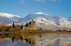 Kilchurn Castle, on Loch Awe was built in the mid-15th century as the base of the Campbells of Glenorchy. Seen here the castle is bathed in the early morning light of a winter sunrise.The most snow on the hills so far this winter.. (c) Stephen Lawson | Edinburgh Elite media