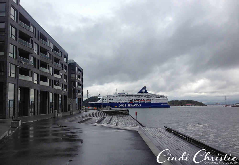 A DFDS Seaways ferry to Copenhagen, Denmark, passes the new Sørenga housing development in Oslo, Norway,  on May 12, 2013. It takes a little more than 16 hours to travel between the two Scandinavian cities. (© 2013 Cindi Christie/Cyanpixel)