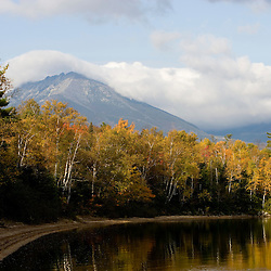 Clouds drape the summit of Mount Katahdin Lake as seen from Maine's Katahdin Lake.  Near Baxter State Park.