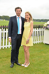 LAURENT & CARINE FENIOU at the Cartier Queen's Cup Polo final at Guard's Polo Club, Smiths Lawn, Windsor Great Park, Egham, Surrey on 14th June 2015