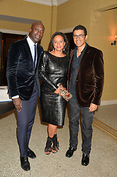 Left to right, OZWALD BOATENG, ISABEL DOS SANTOS and SINDIKA DOKOLO at the Sindika Dokolo Art Foundation Dinner held at The Cafe Royal, Regent Street, London on 18th October 2014.