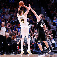 01 April 2018: Denver Nuggets center Nikola Jokic (15) takes a jump shot over Milwaukee Bucks center Tyler Zeller (44) during the Denver Nuggets 128-125 victory over the Milwaukee Bucks, at the Pepsi Center, Denver, Colorado, USA.
