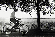 Retired man bicycling Holland.