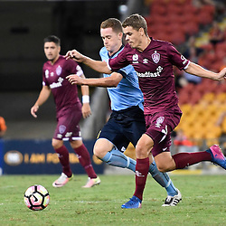 BRISBANE, AUSTRALIA - FEBRUARY 3: Thomas Kristensen of the Roar and Brandon O'Neill of Sydney compete for the ball during the round 18 Hyundai A-League match between the Brisbane Roar and Sydney FC at Suncorp Stadium on February 3, 2017 in Brisbane, Australia. (Photo by Patrick Kearney/Brisbane Roar)