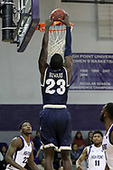 HIGH POINT, NC - JANUARY 06: Charleston Southern's Javis Howard dunks the ball. The High Point University of Panthers hosted the Charleston Southern University Buccaneers on January 6, 2018 at Millis Athletic Convocation Center in High Point, NC in a Division I men's college basketball game. HPU won the game 80-59.