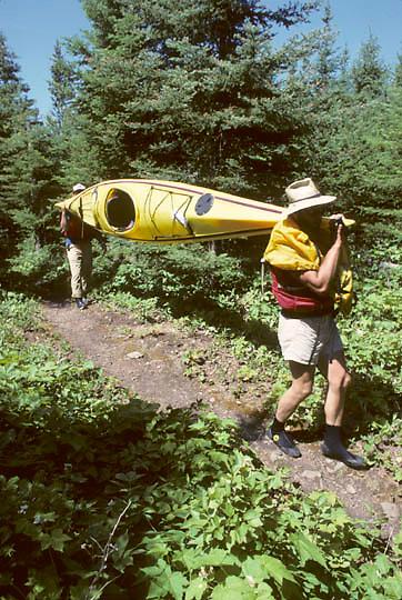 Isle Royale National Park portaging kayak from Five Finger Bay to Duncan Bay. Michigan.