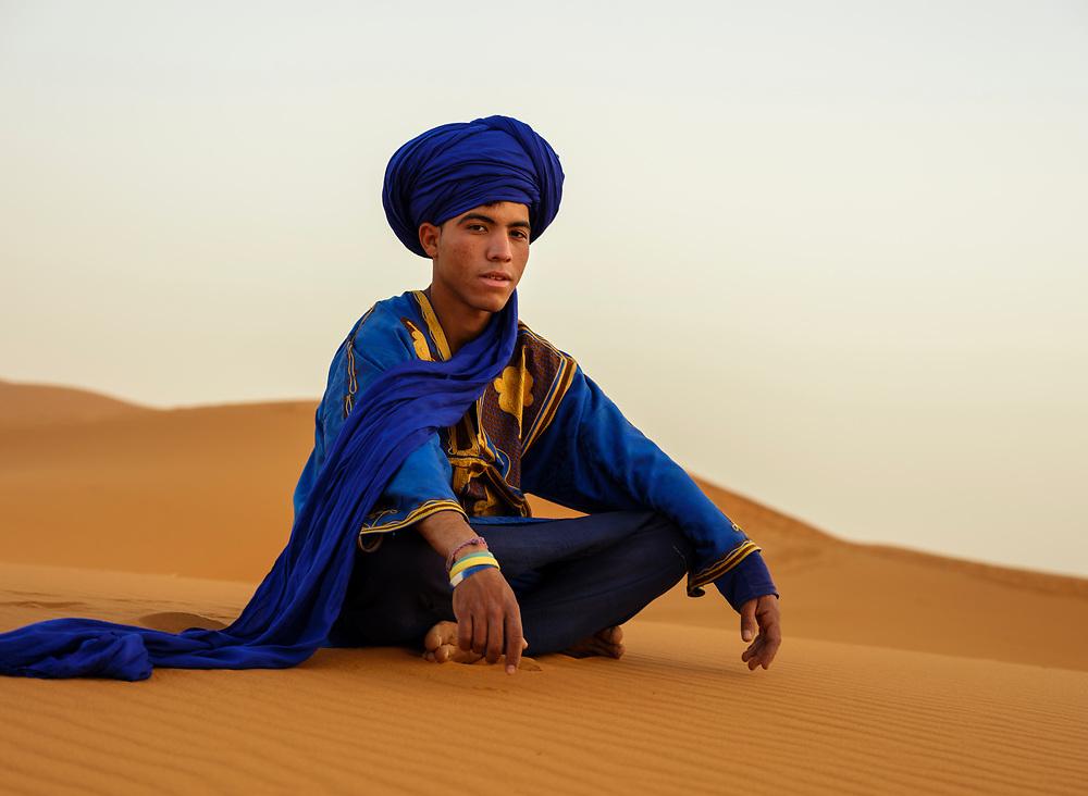 MEKNES - TAFILALET, MOROCCO - CIRCA APRIL 2017: Berber seating on the dunes of the Sahara Desert