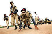Recruits are exercising at the Shaheed Benazir Bhutto Elite Police Training Center, a commando and anti-terrorism academy on the outskirts of Karachi. The training center was founded by retired colonel Abdul Wahid Khan, a brave officer who served as a gunship helicopter pilot in the Pakistani Air Force and around the globe with the United Nations, but who's first task as a young army officer in 1979 was to train Afghan Mujahedeen to fight the Soviet Army, the very Mujahedeen that are today's Taleban.