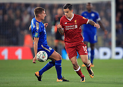 Liverpool's Philippe Coutinho (right) and Leicester City's Marc Albrighton battle for the ball during the Carabao Cup, third round match at the King Power Stadium, Leicester.