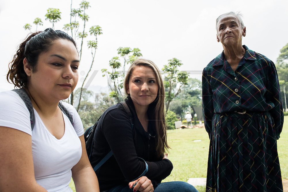"""30/03/2016 - Medellin: Colombia: Mexican tourists, Naib Tapia, 23, and Yanira Osuna, 23, visit the tomb of Pablo Escobar in Monte Sacro cemetery in Medellin. Tours focusing on the life and death of Pablo Escobar are becoming quite popular among international tourists that visit Medellín. In recent times more than 10 tour operators have started to give the tour, helped by the interest generated by Netflix """"Narcos"""" series. (Eduardo Leal)"""