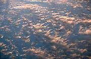 Sunlit alto cumulus clouds