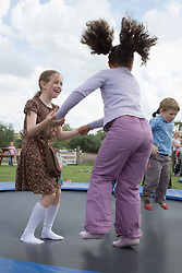 Children bouncing on a trampoline,