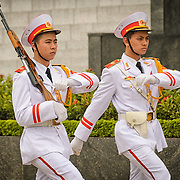 Two soldiers goosestep their way to the entrance of the Ho Chi Minh Mausoleum as part of the changing of the guard ceremony. A large memorial in downtown Hanoi surrounded by Ba Dinh Square, the Ho Chi Minh Mausoleum houses the embalmed body of former Vietnamese leader and founding president Ho Chi Minh.