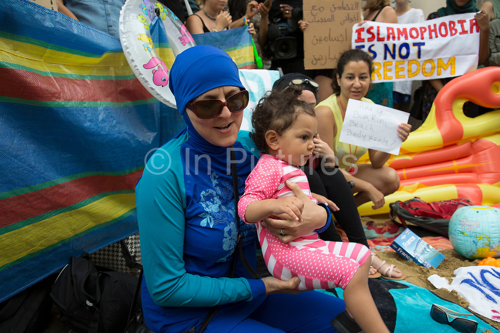 """Wear what you want protest at the French embassy against the burkini ban for Muslim women onFrance's beaches on 25th August 2016 in London, United Kingdom. Activists called on fellow supporters to descend on Knightsbridge saying """"Come along to the French embassy and wear what you want - burkinis, bikinis, anything goes. Bring beach gear: beach umbrellas, towels, bat and ball, boules... Join us at the French embassy to show solidarity with French Muslim women and to call for the repeal of this oppressive law by the French Government."""""""