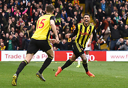 Watford's Etienne Capoue (right) celebrates his sides first goal of the game with Craig Cathcart