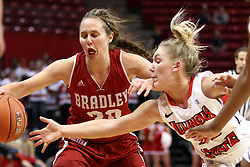 30 January 2015:  Taylor Stewart reaches for a ball being handled by Whitney Tinjum during an NCAA women's basketball game between the Bradley Braves and the Illinois Sate Redbirds at Redbird Arena in Normal IL