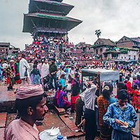 Newari Hindus in Bhaktapur, Nepal, gather to celebrate Gai Jatra (the cow festival) where families honor their dead and march through the city, performing  to encourage their passing to heaven.