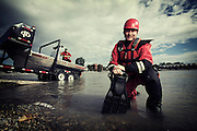 Vern McNeice of the Calgary Fire department river water rescue team on the Bow River in Calgary, Alberta, June 14, 2012. Photograph by Todd Korol