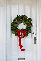 December 21, 2017 - Charleston, South Carolina, United States of America - A traditional low country Magnolia leaf Christmas wreath hangs from a wooden door on a historic home along King Street in Charleston, SC. (Credit Image: © Richard Ellis via ZUMA Wire)