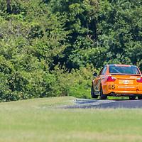 Alton, VA - Aug 26, 2016:  The Murillo Racing BMW 328i races through the turns at the Oak Tree Grand Prix at Virginia International Raceway in Alton, VA.