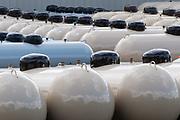 Graphic pattern of new propane tanks in a storage area, morning light, October, Kalkaska County, Kalkaska, Michigan, USA