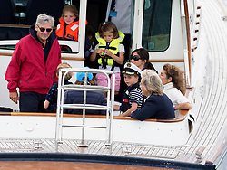 Prince George and Princess Charlotte (blue dress) are watched by Carole Middleton (blue hat) and Michael MIddleton (red coat) as the Duke and Duchess of Cambridge participate in the King's Cup Regatta on the Isle of Wight.<br />