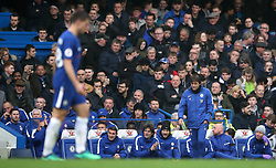 Chelsea manager Antonio Conte (right) looks dejected during the Premier League match at Stamford Bridge, London.