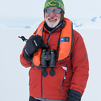 Portrait of Naturalist Eduardo Shaw taken on the fast ice in Crystal Sound in Antarctica.