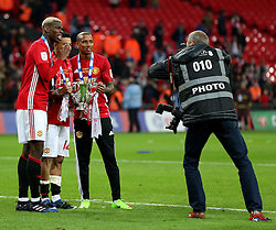 Paul Pogba, Jesse Lingard and Ashley Young of Manchester United pose for pictures with the EFL Trophy - Mandatory by-line: Matt McNulty/JMP - 26/02/2017 - FOOTBALL - Wembley Stadium - London, England - Manchester United v Southampton - EFL Cup Final