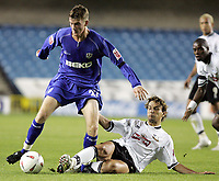 Photo:  Frances Leader.Digitalsport<br /> Millwall v Derby county. Coca-Cola championship league one. The Den.<br /> 22/09/2004<br /> Millwall's Barry Cogan is tackled by Derby's Inigo Idiakez.