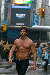 shirtless bodybuilder walking in Times Square,NYC