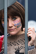 Moscow, Russia, 01/10/2012..A Pussy Riot supporter refused entry to Moscow City appeals court precincts stares in through security bars from outside. Supporters and opponents of band members Maria Alyokhina, Yekaterina Samutsevich and Nadezhda Tolokonnikova demonstrated outside the court as the three appealed against their two-year jail sentence for their anti-Putin performance inside the Christ The Saviour Cathedral.