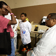 GREENVILLE, MS - September 3, 2005:  Dr. Ronald Myers, dealing with the Hurricane Katrina crisis professionally and personally, checks on Katrina evacuees in Greenville, Mississippi on September 3, 2005. As a doctor and advocate for the poor, he is treating evacuees from New Orleans and other parts of Louisiana and Mississippi in shelters and at homes where the evacuees have taken up residence. His personal home and his in-laws home were severely damaged and all are living in a Ramada Inn...(Photo by Todd Bigelow/Aurora)..